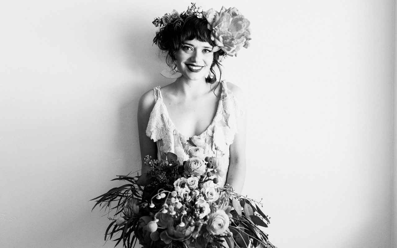 Beautiful bride posing with her wedding bouquet in Placerville