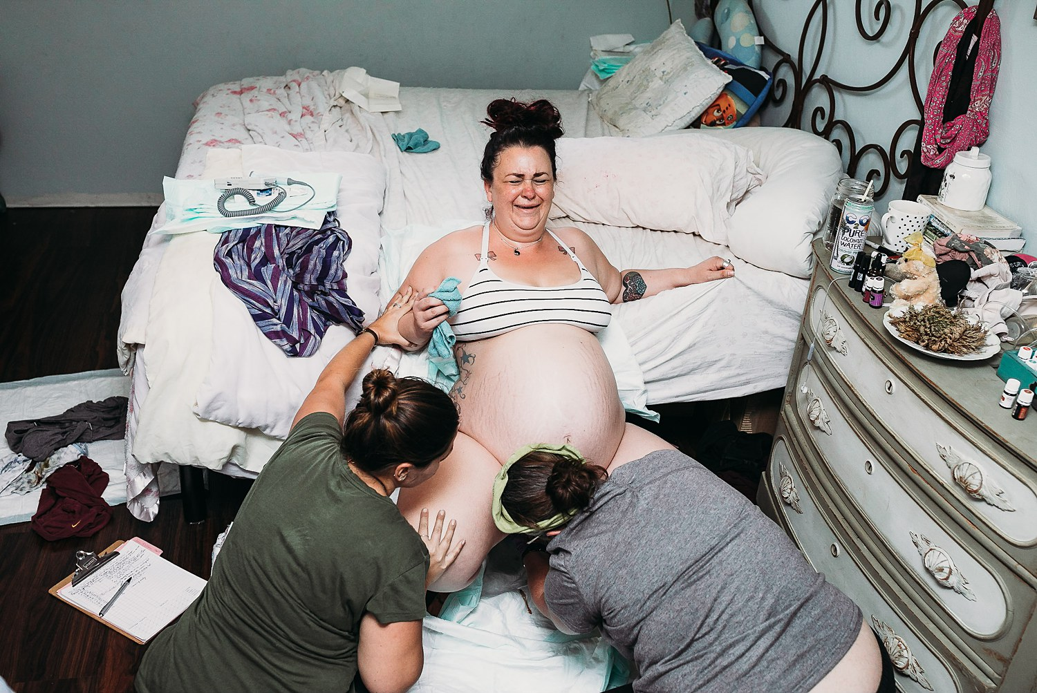 Mother giving birth in her Grass Valley, California home.