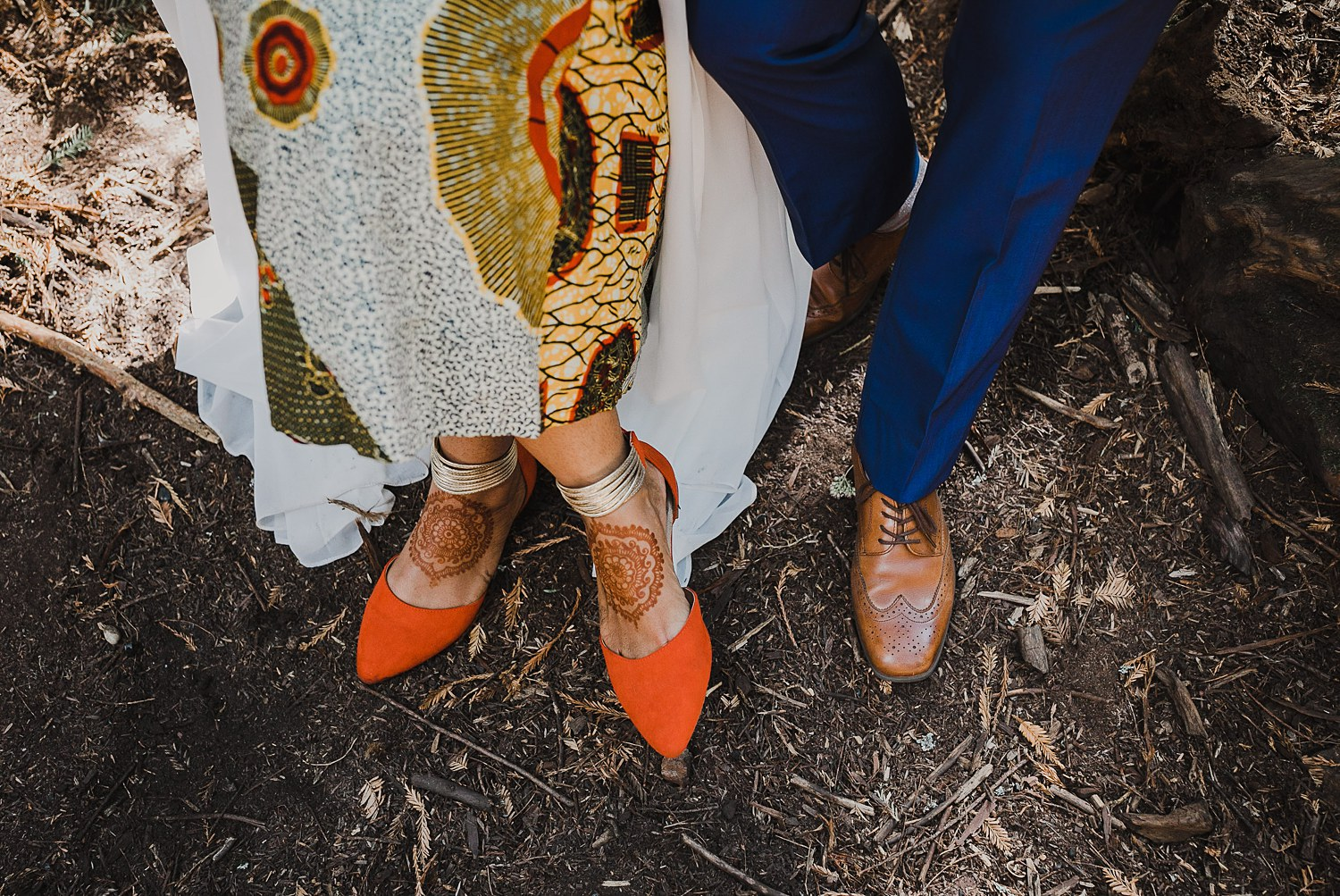 Couple shows off their wedding shoes on wedding day.
