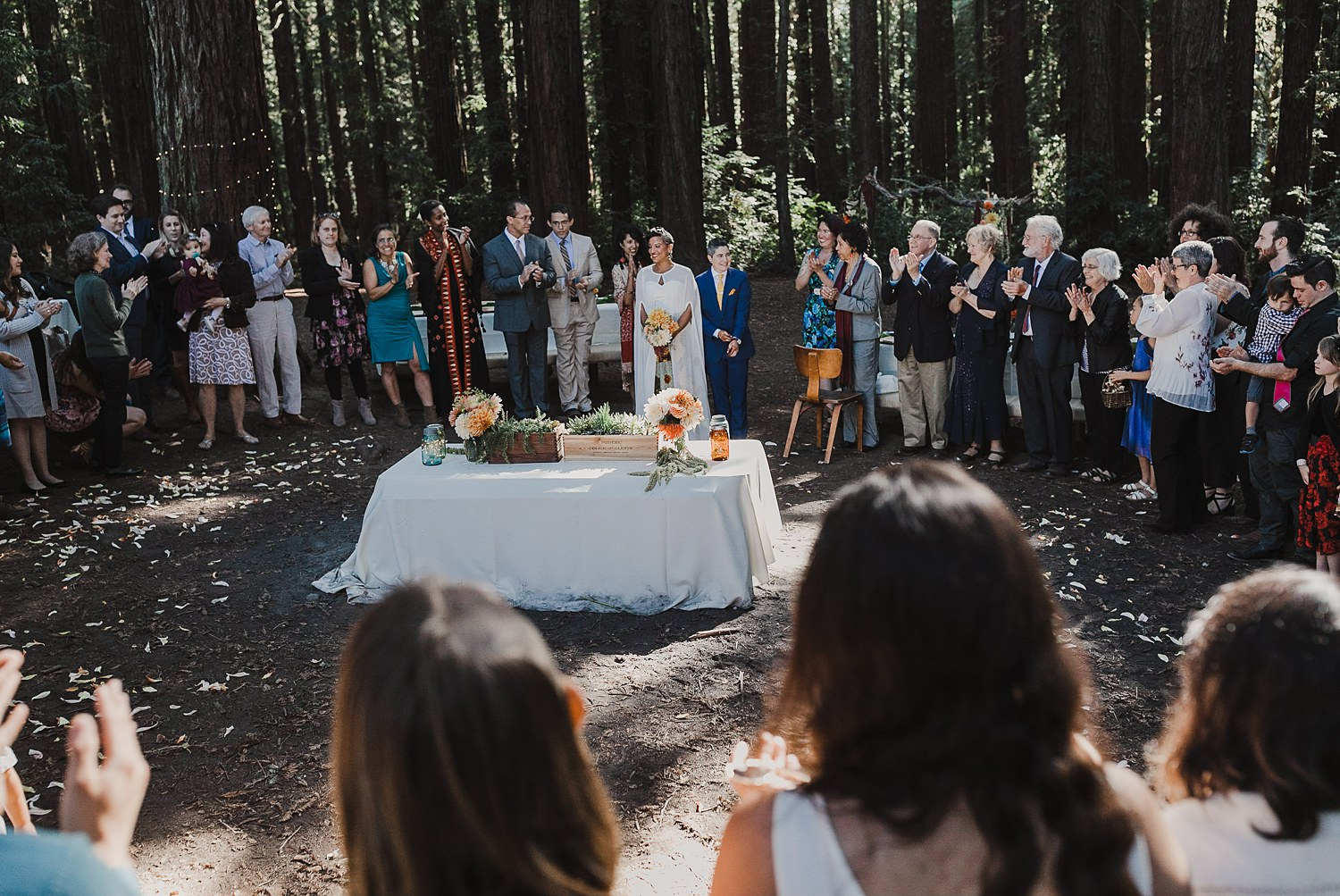 Wedding ceremony in Joaquin Miller Park, Oakland, CA.