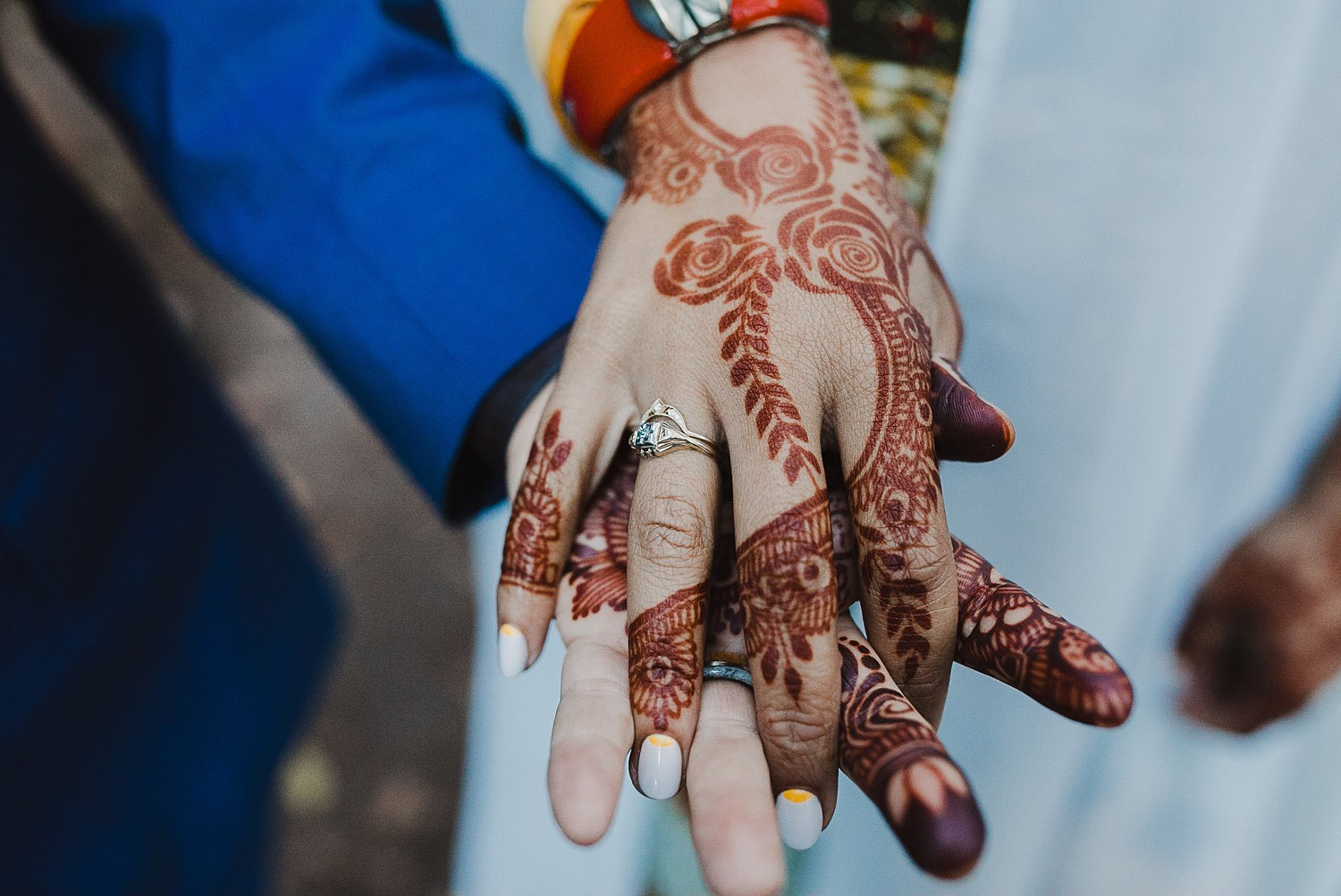 Wedding ring on a hand decorated with wedding henna.